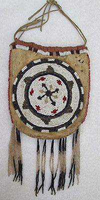 High Plains Beaded Bag - A magic pouch might protect a deck of tarot cards when they aren't being used, or you might assemble a special one that you can wear if you were doing magickal work for manifesting or for healing work. Larger pouches sometimes can hold small musical instruments like shakers or bells.
