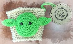 "Back by popular demand, and in the nick of time for ""Star Wars: The Force Awakens""! Get your Yoda cup holder and may the force help not to burn your precious mitts. Handmade of high quality yarn each"