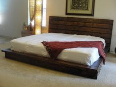 I want to try to make this bed from recycled pallets, then paint it a dark gray!