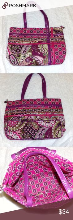 """Vera Bradley Shoulder Tote Bag Very Berry Paisley Vera Bradley Shoulder Tote Bag Retired Very Berry Paisley Pattern Great Vintage find This item is in excellent unused condition and looks brand new! Is a nice zip bag with the folding bottom. It has a zippered compartment inside and the leather or leather-like handles (making it a much rarer bag than the usual cloth handles) MEASUREMENTS H-10""""/L-14""""/ Strap Drop 11"""" BUNDLE 2 or more of our items and SAVE even more or make us a FAIR OFFER the…"""