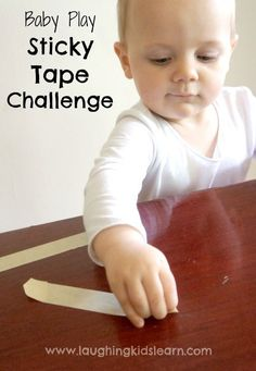 Sticky tape challenge for babies is great fun, helps develop their fine motor skills and concentration. - Laughing Kids Learn