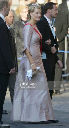 Crown Prince Haakon and his wife Crown Princess Mette-Marit arrive at the Royal Theatre to attend a gala performance on May 13, 2004 in honor of the upcoming May 14th wedding of Danish Crown Prince Frederik and Miss Mary Elizabeth Donaldson in Copenhagen, Denmark. (Photo by Pascal Le Segretain/Getty Images)