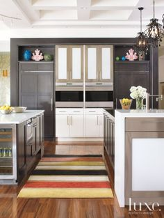 Luxe | Kitchens Eclectic Kitchen with Black and White Cabinetry