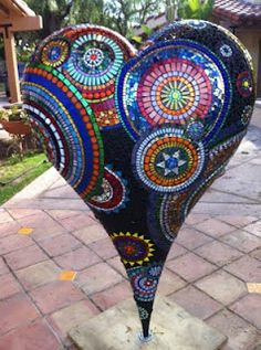 Incredible mosaic heart, nearly 5' tall, by Sue Ferrante. The work in progress pics are amazing to see.
