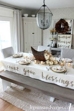 { Love the bench and the rug under the table} Count Your Blessings Tablecloth