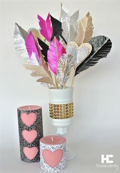 """Paper feathers, paper arrows and paper hearts in a DIY vase. """"Candle covers/wraps"""" for Valentines' Day. @yearofcelebrations"""