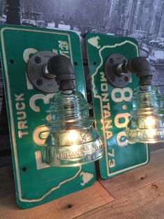 Steampunk 1973 Montana License Plate Whitall Tatum Pipe Lamp Sconce Pair Featured is a pair handmade pipe lamp sconces mounted on 1973 Montana License Plates. These plates are light green and are not matching. These plates are in used condition and have some signs of age. Constructed