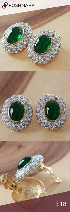 """Vintage Emerald & Rhinestone Clip On Stud Earrings 1950's Emerald and Rhinestone Yellow Gold Clip On Stud Earrings  * 1 missing stone from each earring * Stud style Clip-On earrings * Earrings measure approximately 1.25"""" x 1.25"""" each. * Emerald measures approximately 1 inch. * Gently used with signs of vintage wear * Hallmark stamp shown in last 2 pictures - script BB Inside an oval Vintage Jewelry Earrings"""