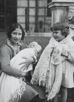 Princess Elizabeth, Duchess of York, with her daughters:  the newborn Princess Margaret and her eldest, Princess Elizabeth, now Queen Elizabeth II.  Little Elizabeth seems rather pleased with her new sister.