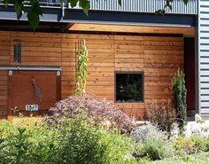 Knotty Cedar Siding adds rustic charm to this modern home. Cedar Cladding, Cedar Siding, Exterior Siding, Western Red Cedar Lumber, Port Orford Cedar, Building Materials, Facade, Pergola, Outdoor Structures