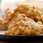 Marinating the chicken in spiced buttermilk helps keep the chicken nice and tender, and my trick for the crunchiest coating is a sprinkle of baking powder in the flour mix.