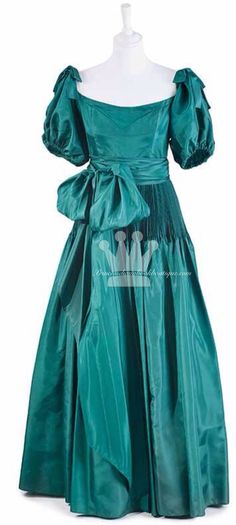 The Ballgown by Nettie Vogues, 1981 Emerald green, partially pleated taffeta. Labelled A Nettie Vogues Model London W.1. Designer  Graham Wren. This dress is the only other (and first) original version of the engagement dress of Diana Princess of Wales. The previous owner purchased the dress from Nettie Vogues shortly before Lady Diana's official photoshoot, but after the Princess chose this particular dress, the original buyer was asked not to wear it outside Germany