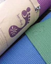 Barefoot Yoga Co. Environmental Yoga Mat.  Made of PER (Polymer Environmental Resin), the Barefoot Environmental Mat is considerably more sensitive to the environment and your health than mats made of PVC. PER does not contain phthalates, dioxins and furans, phenal, or heavy metals and its method of production is completely non-toxic. Note that it will arrive in a protective plastic wrap that is also eco-friendly.The PER mat is Latex free.