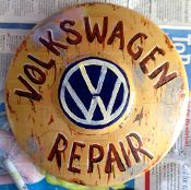 "Original art on a VW hubcap by Stovepipe, entitled ""Repair Shop"""