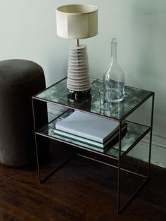 OCHRE side moon table with shelf, featuring mercury glass top and shelf with patinated steel frame.