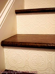 textured wallpaper stairs same as dining room ceiling