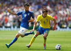 Marco Parolo of Italy looks on as Albin Ekdal of Sweden runs with the ball during the UEFA EURO 2016 Group E match between Italy and Sweden at Stadium Municipal on June 17, 2016 in Toulouse, France.