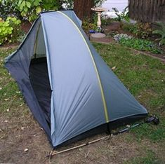 Rainbow Tent by Tarptent. This tent sleeps 1, weighs less than 2 pounds, and has one pole curving side to side, and a cross pole that forms the center beam of the tent ceiling.