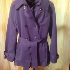 All weather Double Breasted Belted Jacket Extremely well made. Light purple exterior  belted at the end of sleeves. Contrasting lining has bird and flower pattern. Sleeves lined with pinstripe pattern.  Side picked an zipper detail for added character. Hook closure at neck. NWOT.  Fell in love with this but lost weight and is 2 big. Jackets & Coats