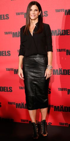 Bullock opted for a sexy leather pencil skirt that she paired with a buttoned top and strappy heels for an all-over black look.