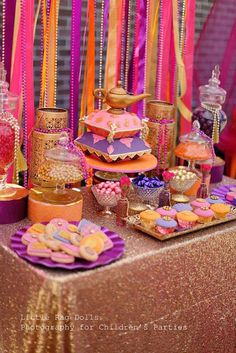 An Arabian Nights themed party with a beautiful Moroccan feel. Impressive dessert table, complete with a genie lantern birthday cake!