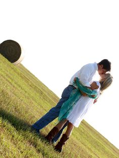 Google Image Result for http://www.heartloveweddings.com/wp-content/uploads/2011/11/engaged-couple-kiss-in-a-field-with-hay-bales-country-boy-meets-city-girl-engagement-session-rustic-engagement-shoot-ZoomWorks-Photography.jpg