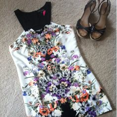 """Love Culture floral dress with cutout halter top.  Beautiful floral design with bright colors.  NWT, never worn!  Measurements laying flat: Top of shoulder to bottom hem: 32"""" Armpit to armpit: 17"""" Waist 17"""" Hips: 18.5"""""""