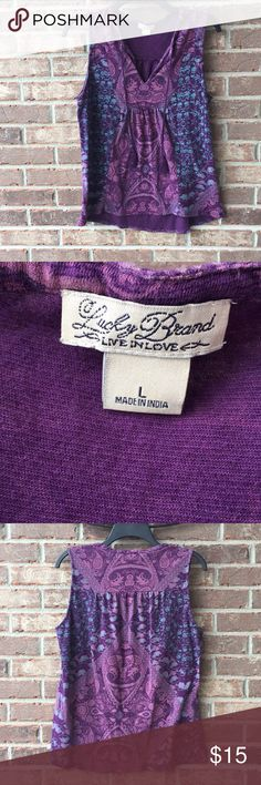 Lucky Brand Summer Tank Cute Lucky Brand purple print tank in a size large. It is used but in good pre-loved condition. Color is truer to last picture two pictures. The others were taken outside.  Please keep in mind that Poshmark does not support returns for sizing issues. This is their policy, not mine. So please be sure to ask any questions you may have. I am happy to measure an item any way I can for you. Happy customers is my priority :) Happy shopping! Lucky Brand Tops Blouses