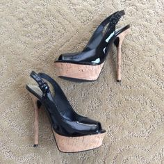 Bebe cork heels Bebe cork slingback stiletto heels in faux black patent. Gently used. Size is marked as 8 but it is mismarked, definitely won't fit an 8. I'm a true 6 and I'm wearing the shoe in the last photo, it's wearable but a little bit large so I think it would best fit a 6.5. bebe Shoes Heels