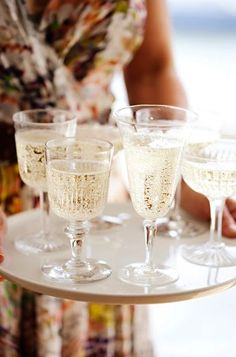 Mix and match vintage champagne glasses for toasting, sooo want to do this!