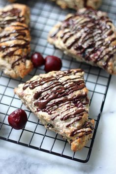 Chocolate Covered Cherry Scones - The perfect scone base is studded with cherries and then covered in a decadent chocolate drizzle!