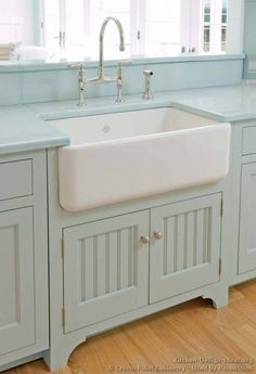 Farmhouse sink, bead board, and beautiful paint color. Perfection.