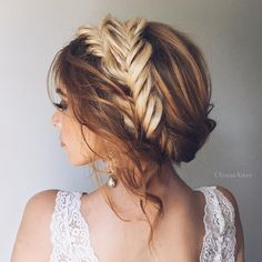 Embrace this ombre look styled into an ethereal braid halo for your wedding hairstyle.