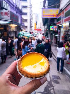Tai Cheong Bakery in Hong Kong will convert even those who don't consider themselves egg tart fans (myself included). The egg custard here is airy, smooth and not overly sweet with a crust that is undeniably buttery and flaky. Hong Kong Street Food, Food In Hong Kong, Hong Kong Travel Tips, Travel Guide, Bali, China Hong Kong, Hongkong, Pudding, China Travel