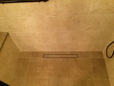 Close-up of LUXE tile insert linear drain in master bath installation by RC Contractors LLC. http://www.rccontractorsllc.com/