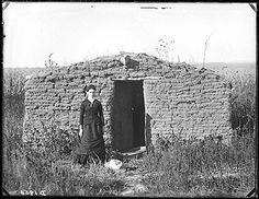 """Miss Mary Longfellow holding down a claim west of Broken Bow, Nebraska.  Photographer's note: """"Miss Longfellow was a very talented young lady and one of the early teachers of Custer County."""""""