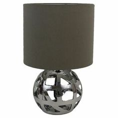 """Metal table lamp with openwork detailing and a grey drum shade.  Product: LampConstruction Material: Metal and fabricColor: Silver and greyAccommodates: (1) Bulb - not includedDimensions: 15"""" H x 9.75"""" Diameter"""