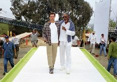Jim Carrey and Morgan Freeman on the set of Bruce Almighty, directed by Tom Shadyac (2003).