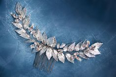 Hey, I found this really awesome Etsy listing at https://www.etsy.com/listing/253864387/silver-bridal-hair-comb-gold-grecian