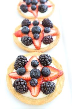 Mini Fruit Pizza's - with sugar cookie crust, lemony cream cheese icing & fresh fruit. Fast, tasty & a serving of fruit....