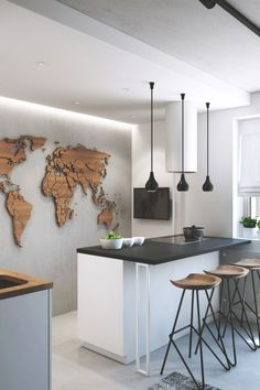 Wood cut-out of world map on wall - Love this for the office.