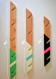Redwood wall mounted racks for snowboards, skateboards, longboards, and skis. Proudly made in the USA.