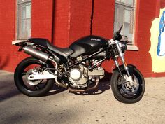 My former bike. 2005 Ducati Monster 620 Dark with high SilMoto exhaust cans.