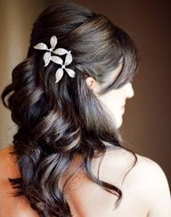 Wedding hair...I like this because its a half up style that looks pretty without her having mile long crazy thick hair...