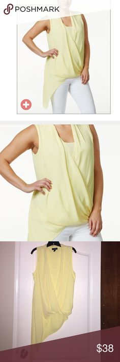 Yellow Asymmetric Hem top. NWOT'S-  Yellow V-neckline pullover surplice top with asymmetric blouson hem.  Longer on the right side. Hits at hip. Attached matching inset at neckline.  Polyester and machine washable. Tops