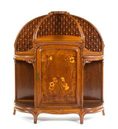 A French Art Nouveau Marquetry Decorated Oak Etagere,  camille gauthier, nancy, circa 1900  of domed form having a central panel door with floral decorations, flanked by shelves, the whole raised on slightly splayed legs, signed in marquetry.