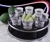 This is great shot serving tray to get the party started! This tequila rack holds 8 shot glasses comfortably with a center dish for holding juicy lime or lemon wedges to chase those tequila shots down the hatch. The finish with metal trim rings look great in any place no matter what your style is.