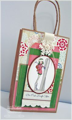 I love how she spruced up a plain kraft gift bag by adding patterned paper (in layers) and a running stitch around the two pieces of paper, then adhered to bag front -- looks as though the paper is stitched to bag; tag added to the front