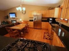 Awesome kitchen with granite counters, stainless appliances, surrounded by 5 acres for privacy and scenic beauty of the north!