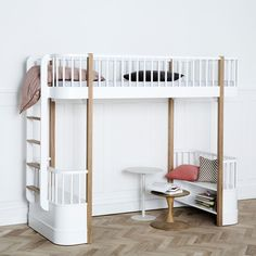 The Wood loft bed is with its unique design one of a kind and perfect for the older child. A space-saving ladder is placed in the end of the loft bed and small benches with shelves underneath the loft bed.